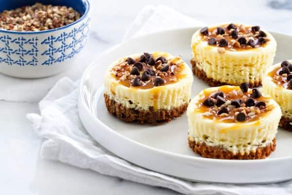 Turtle Cheesecake Cookie Cups are completely indulgent treats. And since they're bite-sized, have two, or three!