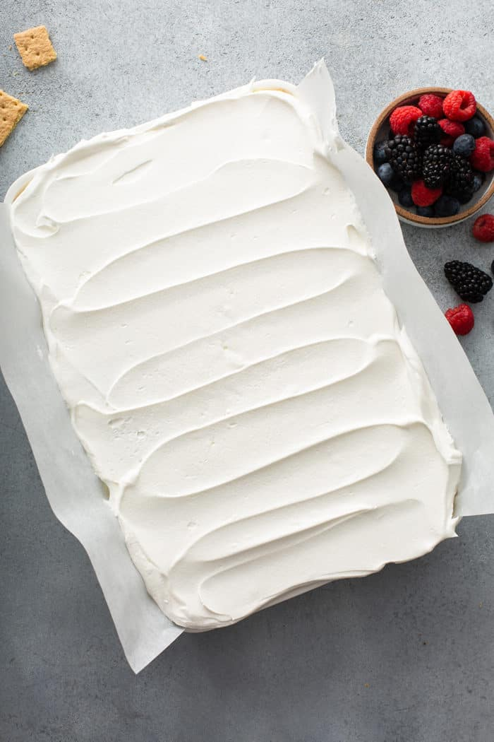 Assembled lemon icebox cake in a white cake pan, ready to chill