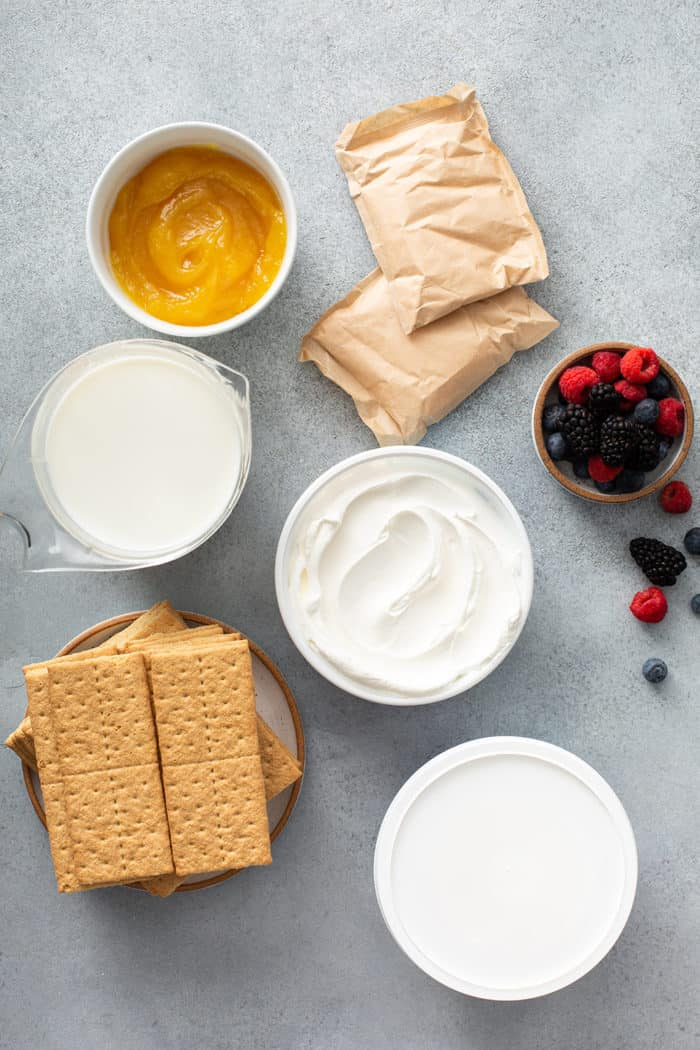 Ingredients for lemon icebox cake assembled on a gray countertop