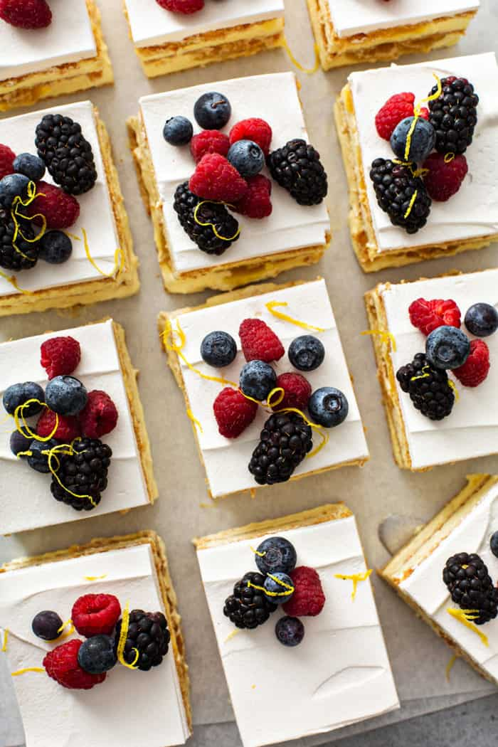 Overhead view of sliced lemon icebox cake topped with fresh berries