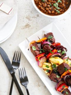 Sweet and Spicy Beef Kebabs are a delicious twist on traditional kebabs. Loaded with bell peppers, red onion, and pineapple - you'll be craving them all summer long!