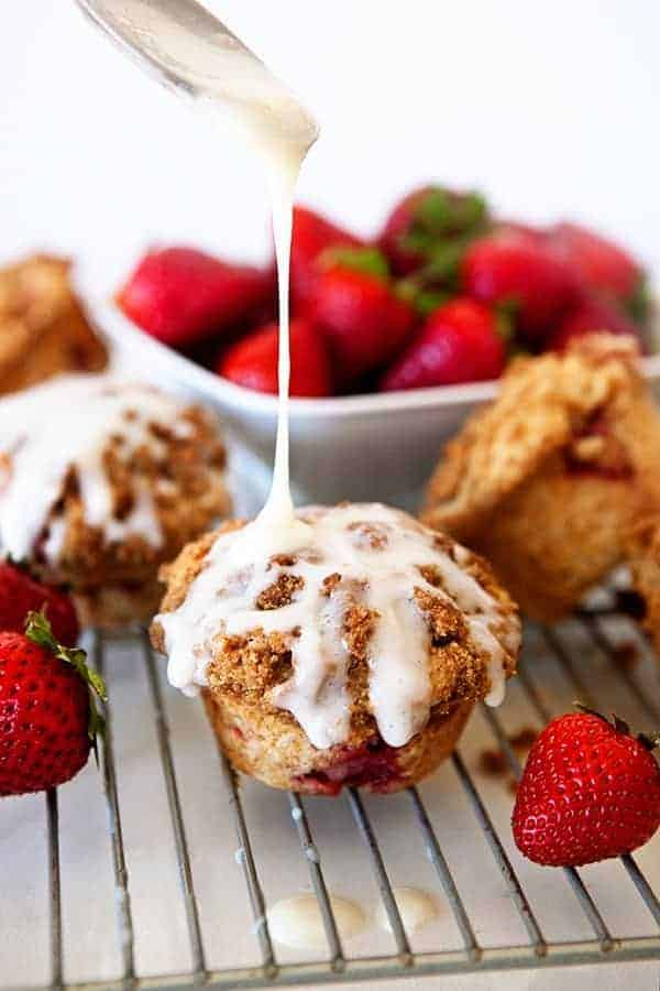 Strawberry Cinnamon Roll Muffins are everything you love about a fruity, sweet cinnamon roll, but in a fraction of the time.