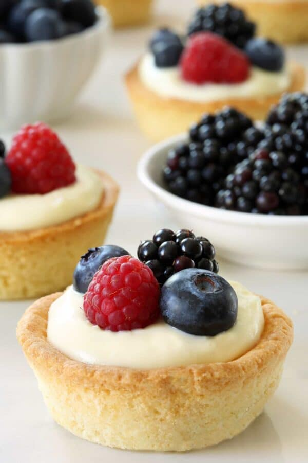 Berry Cookie Cups are loaded with sweet, summer flavor. The sugar cookie crust makes them irresistible. Recipe contains a gluten-free option.