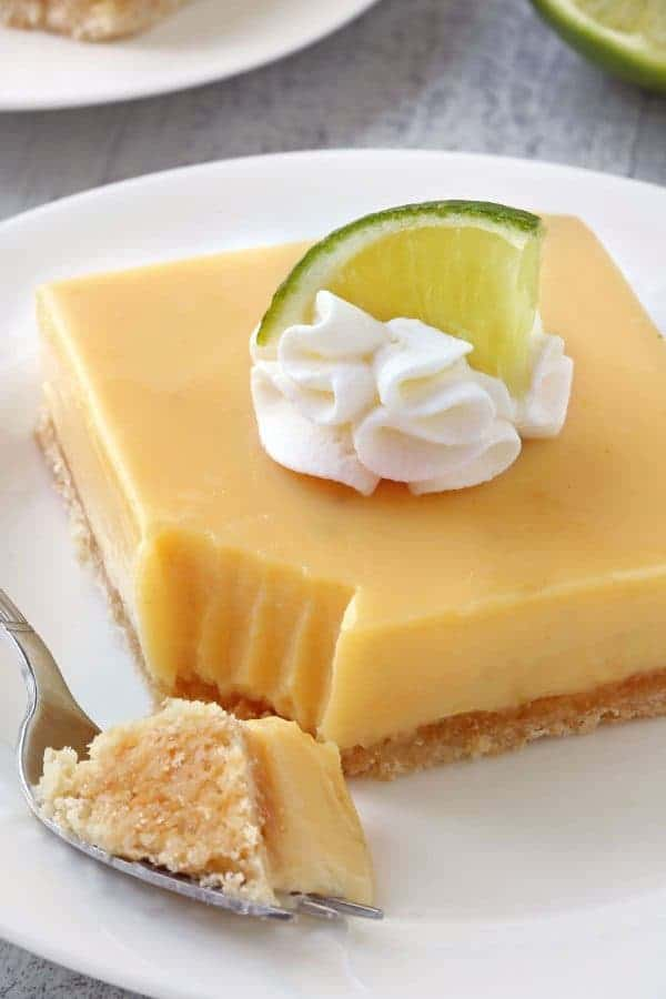 Key Lime Pie Bars are your favorite pie in a delicious bar. Great for a crowd! Recipe has a gluten-free option.