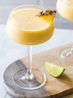 Frozen Pineapple Mango Daiquiris are the ultimate hot weather cocktail: smooth, cold, fruity and not-too-sweet. So amazing for summer.