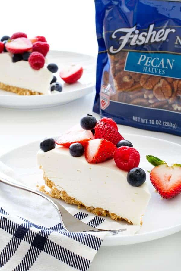 No Bake Frozen Cheesecake combines a sweet and salty crust with a layer of smooth cheesecake filling and fresh berries to create a delicious dessert for any celebration.
