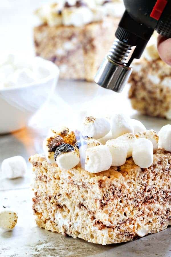 S'mores Marshmallow Crispy Treats have toasted marshmallows right on top. Irresisitible!