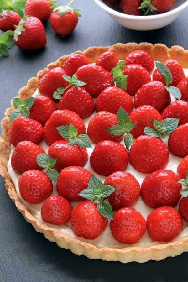 This Strawberry Cream Cheese Tart is loaded with fresh strawberries and a delicious and sweet layer of cream cheese. Perfect for summer!
