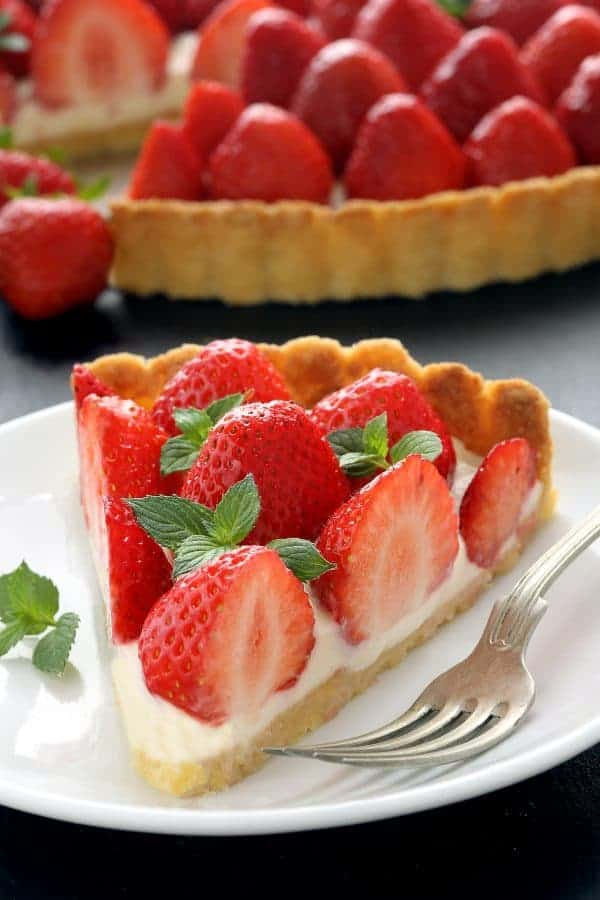 This Strawberry Cream Cheese Tart has a thick layer of sweetened cream cheese and loads of fresh, summer berries. So perfect for any occasion.