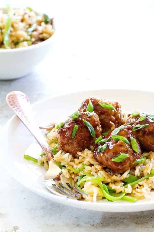 Soy-Ginger Meatballs with Zucchini and Snow Pea Fried Rice are an Asian-inspired meal with exquisite flavors. It'll become a regular in your house!
