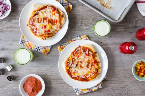 30 Minute Pizza Crust is super quick because there is no need for rising time. Divide the dough into mini crusts so everyone can create their own perfect pizza snack. So fun!