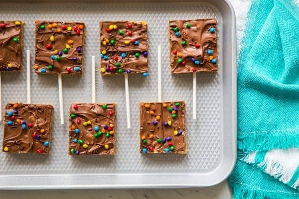 Chocolate Scotcheroos combine creamy peanut butter, rice cereal, and chocolate into one simple and delicious treat. The perfect back-to-school snack!