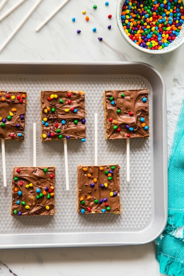Chocolate Scotcheroos combine peanut butter, rice cereal, and chocolate into one simple and delicious treat. A perfect recipe to make with your kiddos!
