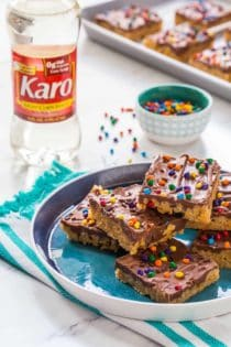 Chocolate Scotcheroos combine peanut butter, crispy cereal, and chocolate into one delicious treat. The perfect back-to-school treat!
