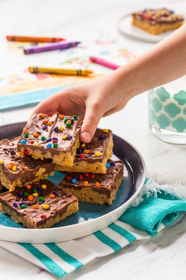 Chocolate Scotcheroos combine peanut butter, crispy rice cereal, and chocolate into one delicious treat. A perfect recipe to make with your kiddos!