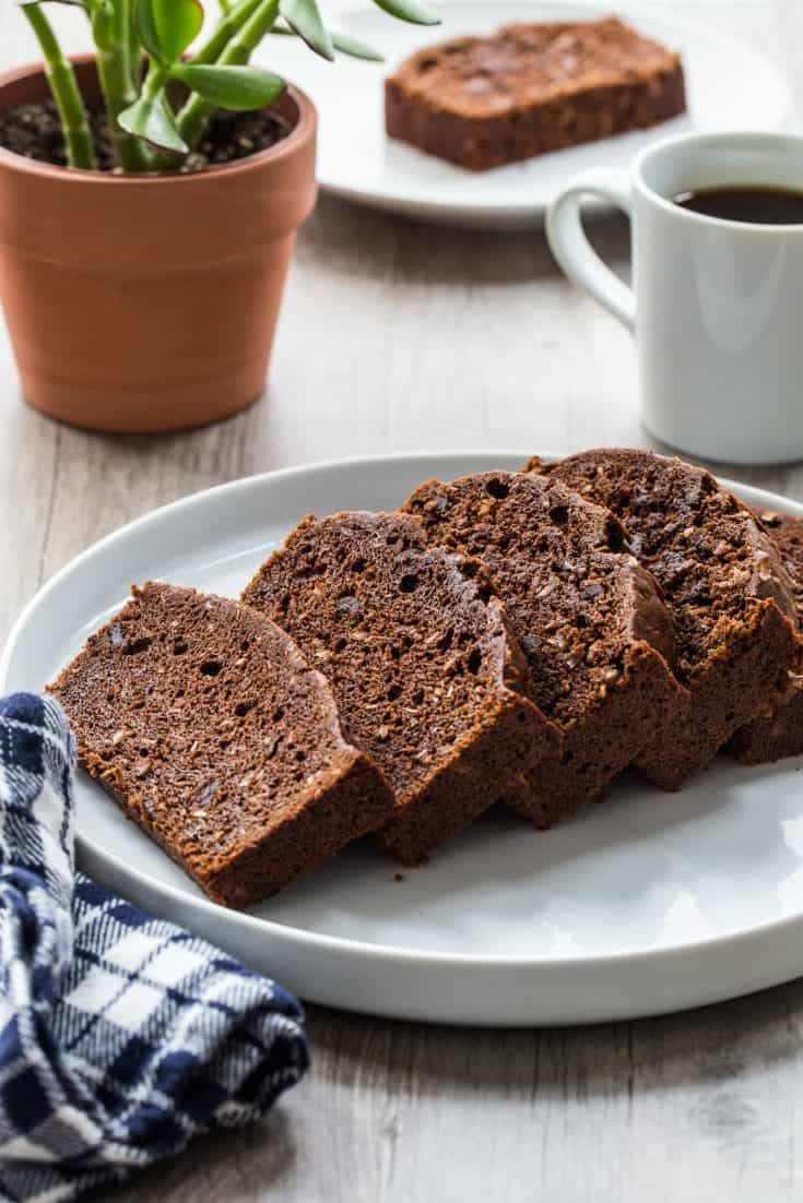 Chocolate Coconut Zucchini Bread is quick, delicious, and the perfect use for garden zucchini. Enjoy a slice with your morning coffee, or serve it up for dessert.