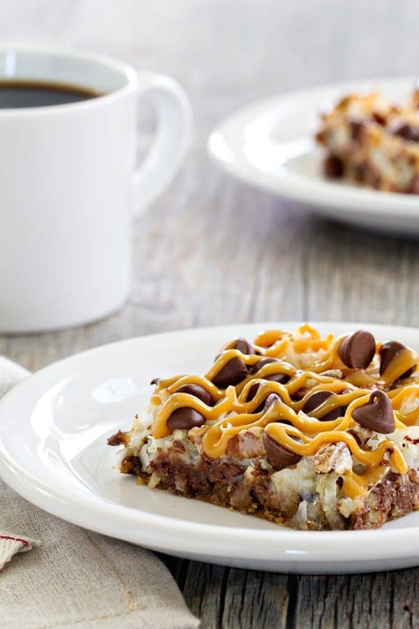 Coconut Caramel Pecan Cookie Bars are a quick and simple dessert thanks to refrigerated cookie dough. Pecans, coconut and caramel make them totally irresistible!