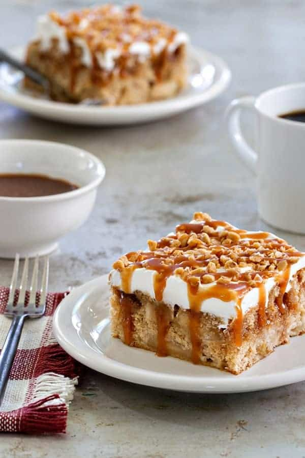 Caramel Apple Poke Cake is super simple to make. The caramel drizzle and toffee bits make it irresistible. So perfect for fall!
