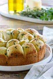 Garlic Parmesan Pull-Apart Bread is great for serving next to turkey and stuffing or spaghetti and meatballs. It's a crowd pleaser, that's for sure!