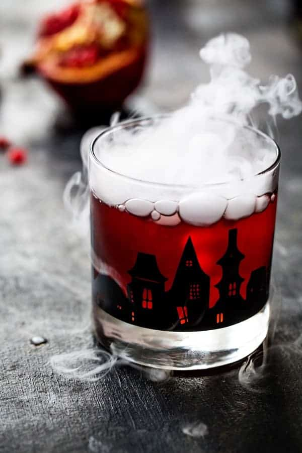 Pomegranate Ginger Punch is the perfect cocktail for an adult Halloween party. Sweet, tart, and just the right amount of kick!