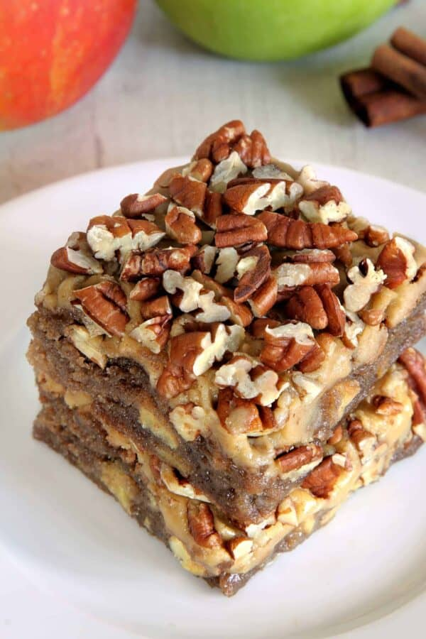 Caramel apple blondies are topped with an easy caramel frosting and pecans to create the perfect fall treat. With a gluten-free option.