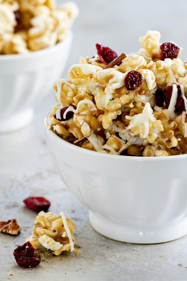 Maple Caramel Corn is brimming with maple marshmallows, chopped pecans, dried cranberries, and a decadent drizzle of white chocolate. So good!