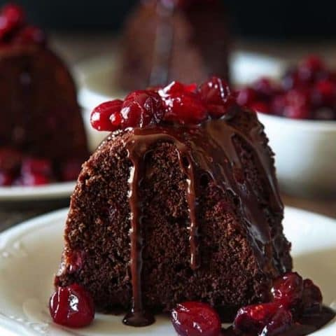 Dark Chocolate Cranberry Bundt Cake showcases the wonderful combination of dark chocolate and cranberries. A great Christmas Eve dessert.