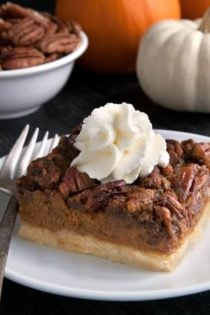 Pumpkin pecan pie bars have a homemade sugar cookie crust, pumpkin filling and a pecan streusel topping. Recipe contains a gluten-free option. These are perfect for Thanksgiving!