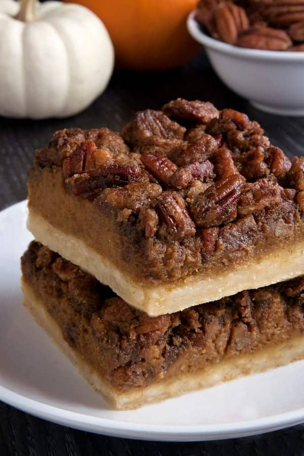Pumpkin pecan pie bars have a homemade sugar cookie crust, pumpkin filling and a pecan streusel topping. With a gluten-free option. Perfect for the holidays!