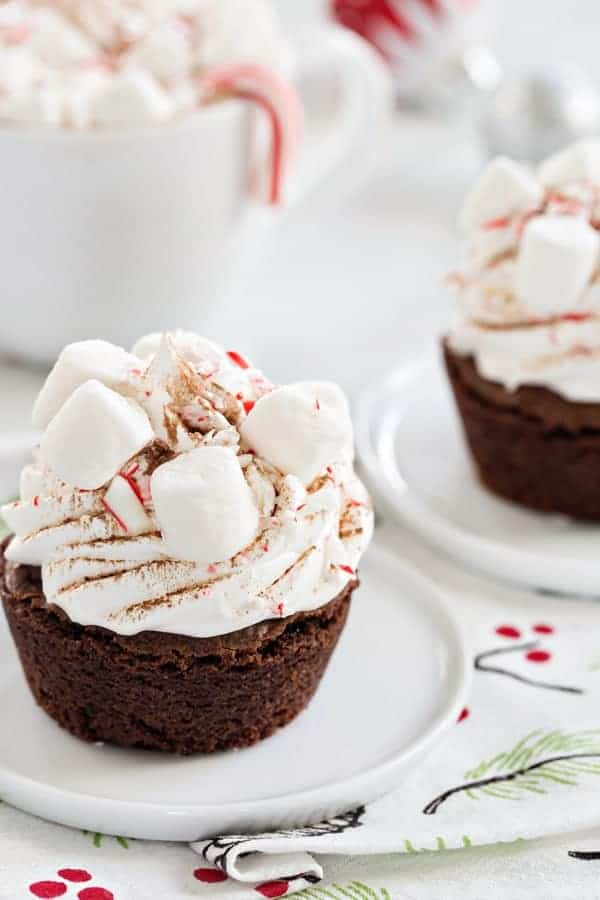 Peppermint Cocoa Brownie Cups are a simple and delicious way to celebrate the season. Mini marshmallows and crushed candy canes make them a dessert the entire family will love