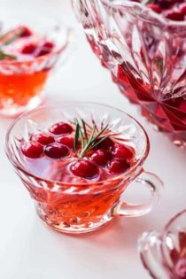 Sparkling Cranberry Rosemary Punch is fun, festive, and perfect for holiday parties! Serve it up with your favorite appetizers.