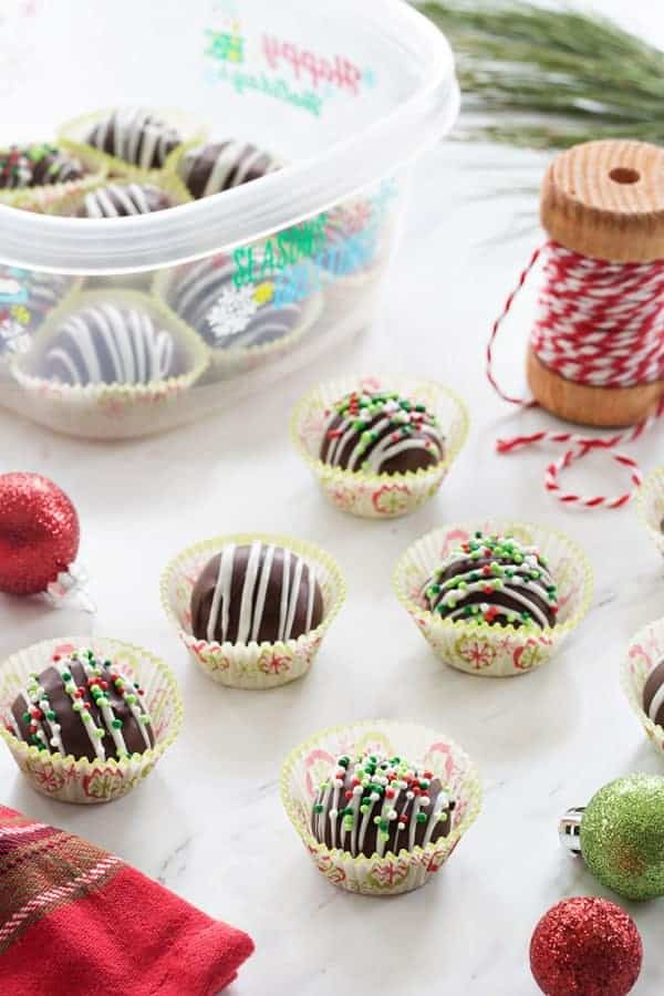 Chocolate Covered Peanut Butter Balls make a festive treat the whole family will love! So fun and festive!