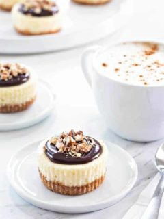 Mini Chocolate Pecan Cheesecakes will cure any nutty chocolate craving you've got going on. They're perfect for your next dinner party, too.