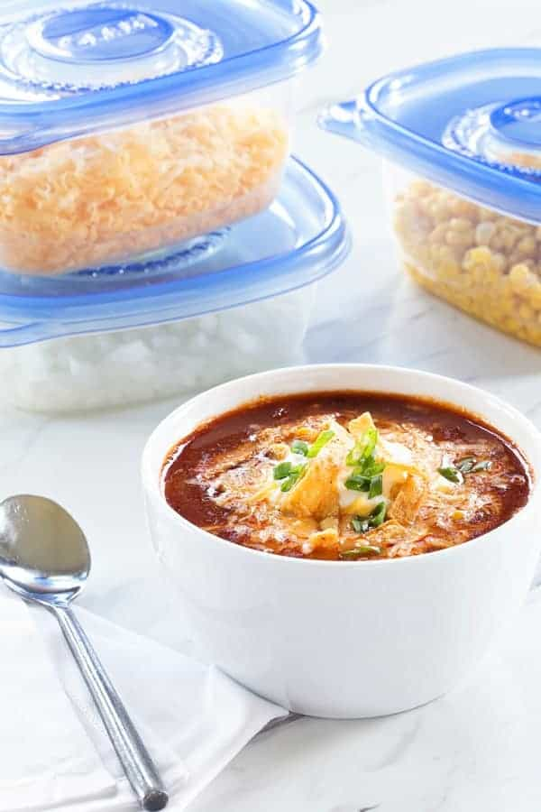 Slow Cooker Taco Soup uses up all your fresh and frozen veggies for a hearty, cozy dinner. The perfect weeknight meal!