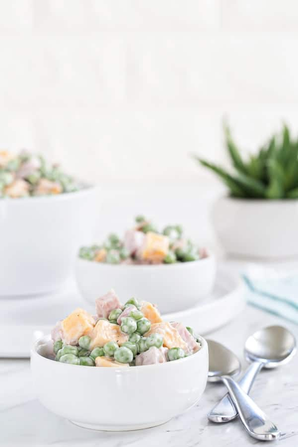 Amish Ham & Pea Salad is a delicious side dish that comes together in minutes. It's a fantastic way to use up leftover holiday ham.
