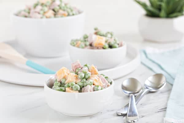 Amish Ham & Pea Salad is a perfect way to use leftover holiday ham. Loaded with peas, cheese, chives and a delicious ranch dressing, it's sure to become a spring favorite.
