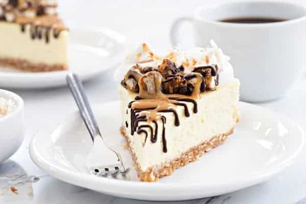 Samoa Cheesecake starts with a coconut shortbread crust and is topped with whipped cream, toasted coconut, melted chocolate and gooey caramel. This will quickly become your new favorite!