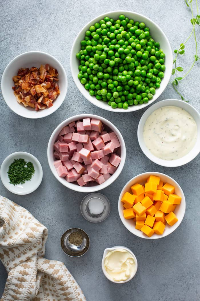 Ingredients for Amish Pea Salad arranged on a gray countertop