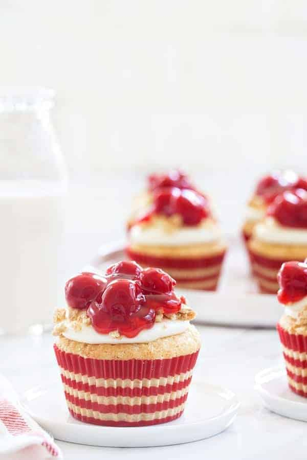 Cherry Cheesecake Cupcakes are a fun and portable take on my favorite dessert. They're perfect for summer barbecues and potlucks.
