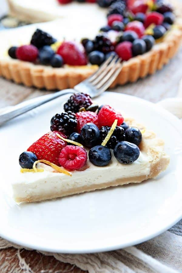 A Lemon Berry Mascarpone Tart is a simple, delicious way to show off all the season's best berries. Simple and perfect for summer entertaining!
