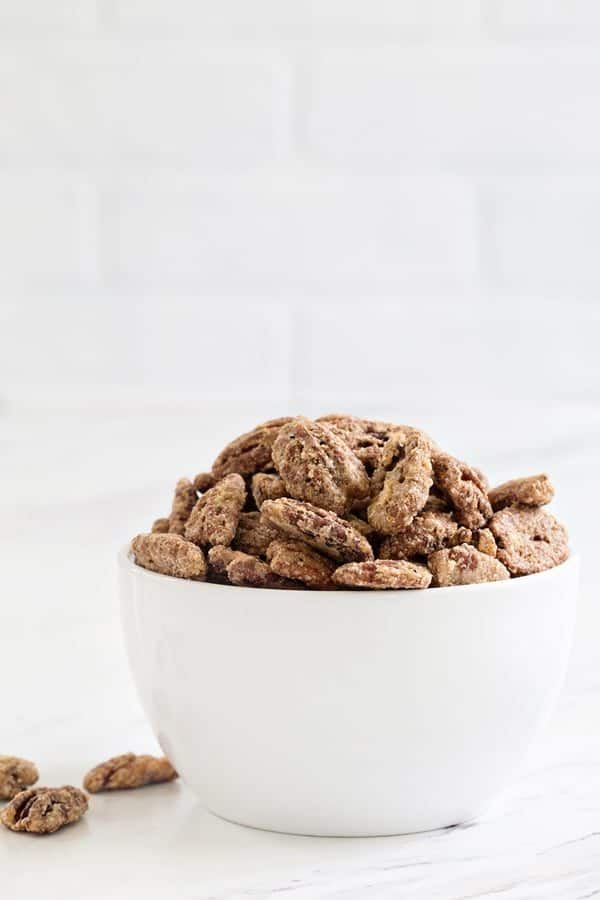 Candied Pecans are sweet, crunchy and totally snack worthy.  Try them on everything from yogurt to salads!