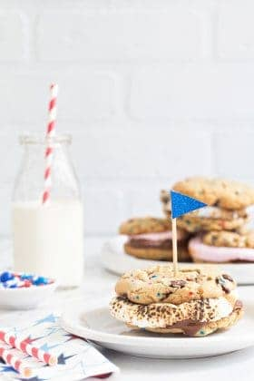 Chocolate Chip Cookie S'mores are loaded with dark chocolate chips and festive sprinkles and then topped with roasted marshmallows and more chocolate. Totally delicious!