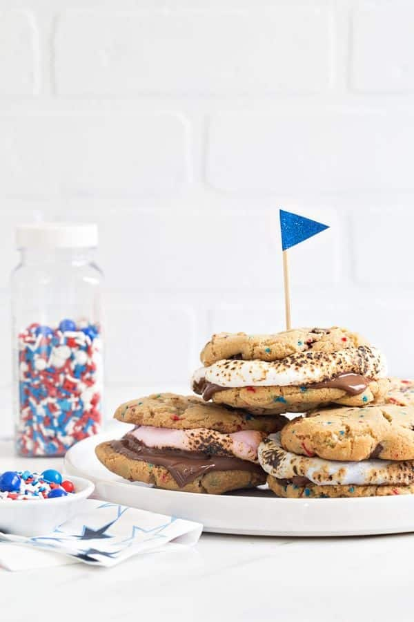 Chocolate Chip Cookie S'mores are loaded with dark chocolate chips and festive sprinkles and then topped with roasted marshmallows and more chocolate. Simple, delicious and perfect for summer!