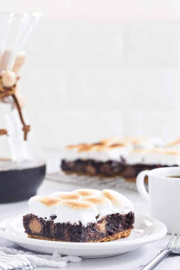 Peanut Butter Cup S'mores Brownies will easily be your new favorite dessert. They're ooey, gooey and totally delicious!