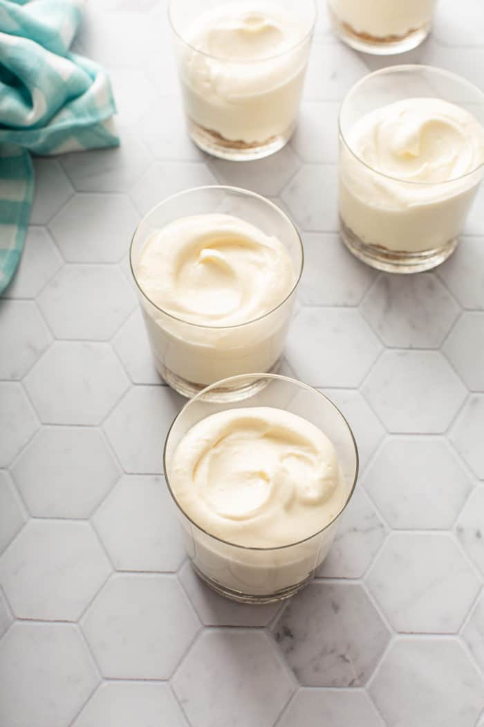 No-bake cheesecakes in individual serving dishes, ready to chill in the refrigerator