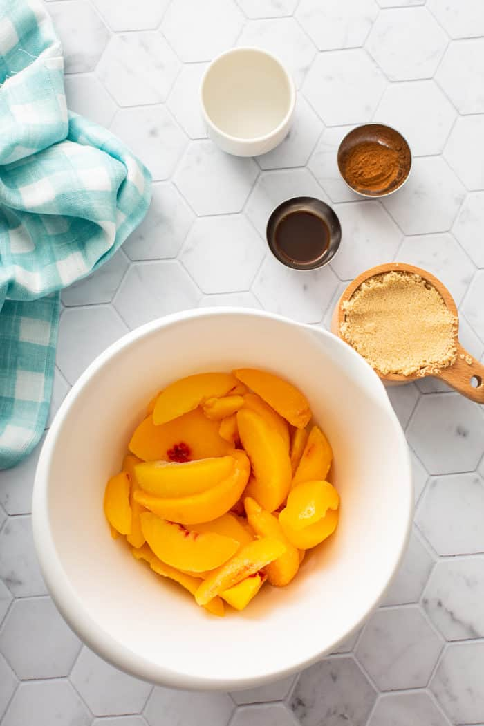 Peach compote ingredients on a white countertop