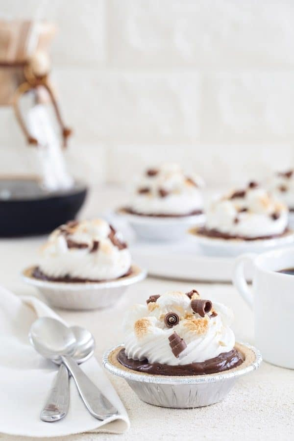 Mini S'mores Pies come together in less than 10 minutes and are the perfect no-bake dessert for summer. Who could possibly resist all this s'mores goodness?