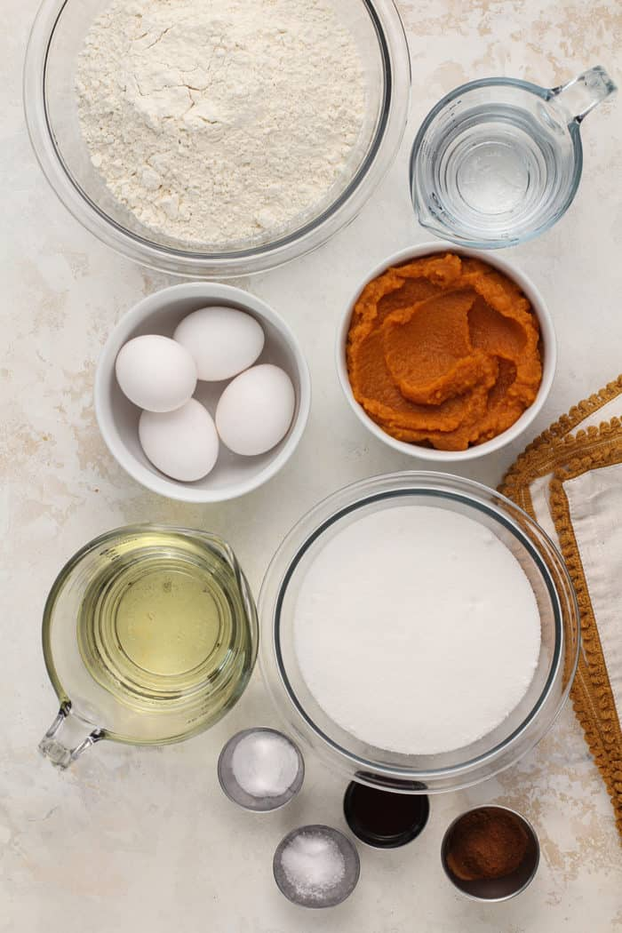 Ingredients for pumpkin bread arranged on a countertop