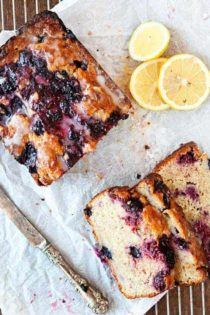 Triple Berry Banana Bread is a fun, fruity twist on the beloved classic. Perfect with your morning cup of coffee!