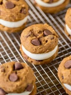 Pumpkin Whoopie Pies are made with fluffy pumpkin chocolate chip cookies and a delicious cream cheese filling to create the perfect dessert for fall.
